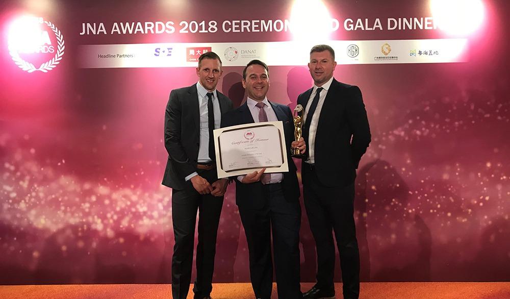 IIDGR's Luke Smith, Jamie Clark and Chris Sanger with the award