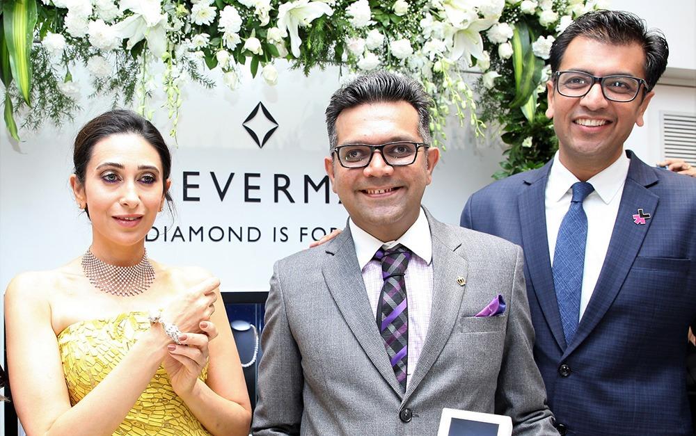 Filmstar Karisma Kapoor Mr. Bhavin Jakhia Director OM Jewellers and Mr. Sachin Jain President Forevermark India at the launch of Forevermarks festive colletion at Om Jewellers